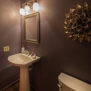 На фото: маленький туалет в стиле современная классика с раздельным унитазом, керамогранитной плиткой, фиолетовыми стенами, полом из керамогранита и раковиной с пьедесталом
