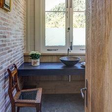 Transitional Powder Room by Wynand Wilsenach Architects