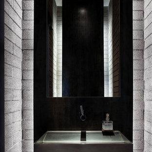 Foto de aseo moderno, de tamaño medio, con puertas de armario grises, lavabo integrado, encimera de acero inoxidable y paredes grises