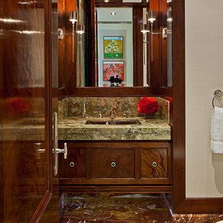 トロントのトランジショナルスタイルのおしゃれなトイレ・洗面所 (落し込みパネル扉のキャビネット、濃色木目調キャビネット、大理石の洗面台、緑のタイル、茶色いタイル、マルチカラーの床、大理石タイル、グリーンの洗面カウンター) の写真