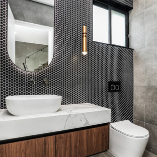 Design ideas for a contemporary powder room in Sydney.