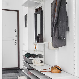 Danish gray floor entryway photo in Moscow with white walls and a white front door