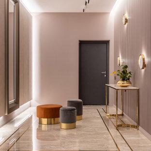 Inspiration pour une porte d'entrée design avec un mur rose, une porte simple et un sol beige.