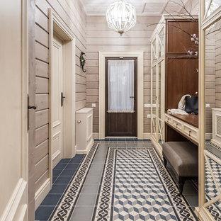 На фото: входная дверь среднего размера в стиле кантри с бежевыми стенами, полом из керамической плитки, одностворчатой входной дверью, стеклянной входной дверью, синим полом, потолком из вагонки и деревянными стенами