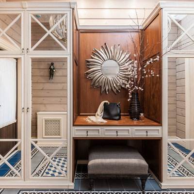 Mid-sized country blue floor, ceramic tile, wood ceiling and wood wall entryway photo in Other with beige walls and a brown front door