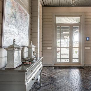 Источник вдохновения для домашнего уюта: входная дверь среднего размера в стиле неоклассика (современная классика) с серыми стенами, полом из керамической плитки, двустворчатой входной дверью, коричневым полом и стеклянной входной дверью