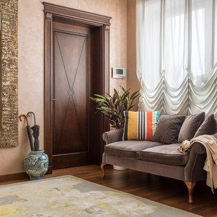 На фото: большая входная дверь в стиле современная классика с бежевыми стенами, темным паркетным полом, одностворчатой входной дверью, входной дверью из темного дерева и коричневым полом
