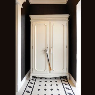 Entryway - small traditional ceramic floor and white floor entryway idea in Other with black walls and a white front door