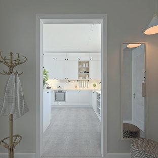 Réalisation d'une petit entrée nordique avec un mur gris, un sol en carrelage de porcelaine, une porte simple, une porte blanche et un sol gris.