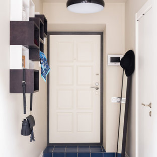 Entryway - contemporary ceramic floor and blue floor entryway idea in Moscow with beige walls and a white front door