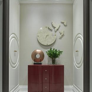 На фото: маленький тамбур в стиле современная классика с бежевыми стенами, полом из керамогранита и разноцветным полом с