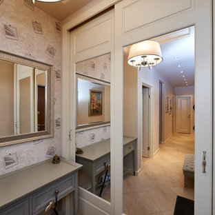 Inspiration for a mid-sized eclectic porcelain floor and multicolored floor entryway remodel in Moscow with beige walls and a white front door