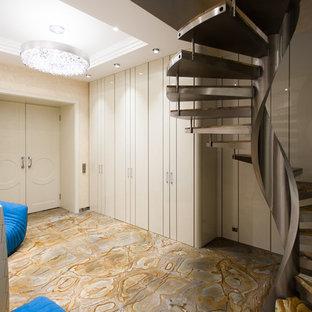 На фото: с высоким бюджетом большие фойе в современном стиле с бежевыми стенами, мраморным полом и разноцветным полом