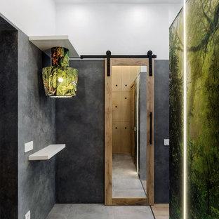 Пример оригинального дизайна интерьера: маленькая узкая прихожая в стиле лофт с полом из керамогранита, серым полом и разноцветными стенами