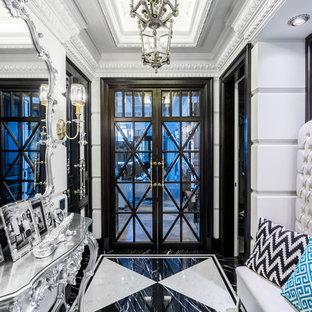 На фото: узкие прихожие в классическом стиле с белыми стенами, разноцветным полом, двустворчатой входной дверью и стеклянной входной дверью