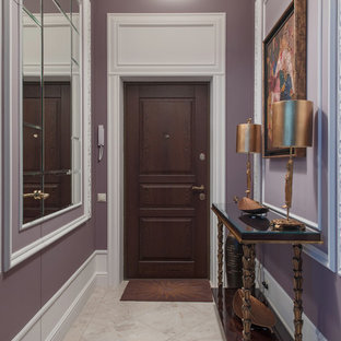 Example of a transitional gray floor entryway design in Other with purple walls and a dark wood front door