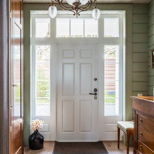 Свежая идея для дизайна: входная дверь среднего размера в классическом стиле с зелеными стенами, одностворчатой входной дверью, белой входной дверью и бежевым полом - отличное фото интерьера