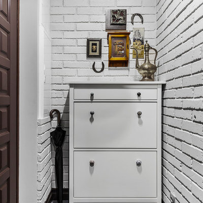 Example of a small classic porcelain tile and gray floor entryway design in Moscow with gray walls and a brown front door