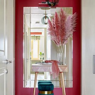 Свежая идея для дизайна: узкая прихожая среднего размера в современном стиле с полом из керамогранита, одностворчатой входной дверью, белой входной дверью, разноцветным полом и красными стенами - отличное фото интерьера
