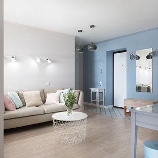 Idéer för små minimalistiska ingångspartier, med blå väggar, klinkergolv i keramik, en enkeldörr, en vit dörr och turkost golv
