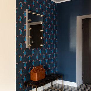 На фото: прихожая в стиле фьюжн с синими стенами, одностворчатой входной дверью, разноцветным полом и обоями на стенах