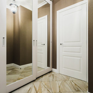 Single front door - mid-sized contemporary porcelain floor single front door idea in Moscow with brown walls and a white front door