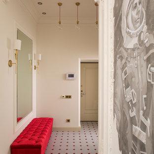 Immagine di un corridoio eclettico con pavimento con piastrelle in ceramica, una porta bianca e pareti bianche