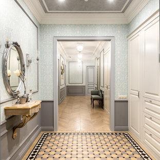 Пример оригинального дизайна интерьера: прихожая среднего размера в стиле современная классика с синими стенами, полом из керамической плитки и разноцветным полом