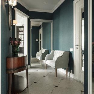 На фото: узкие прихожие в стиле современная классика с синими стенами и разноцветным полом