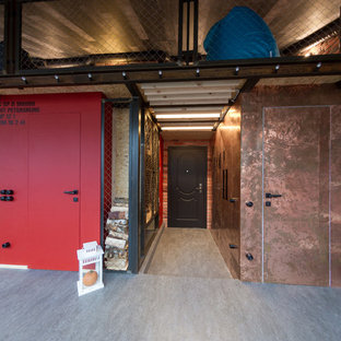 Inspiration for a large industrial linoleum floor entryway remodel in Saint Petersburg with a brown front door