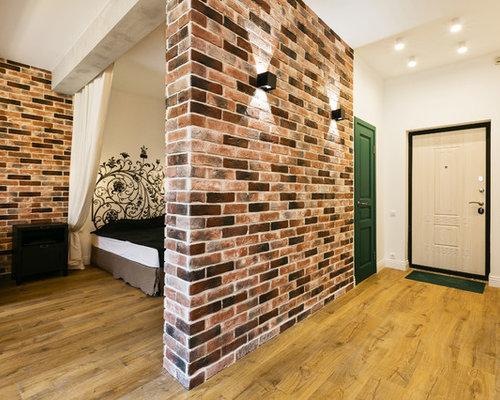 entr e industrielle avec une porte blanche photos et id es d co d 39 entr es de maison ou d. Black Bedroom Furniture Sets. Home Design Ideas