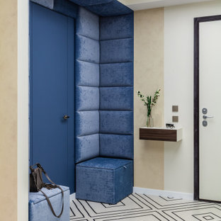 Example of a trendy wall paneling entryway design in Moscow with beige walls and a blue front door