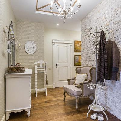 Elegant medium tone wood floor entryway photo in Moscow with beige walls