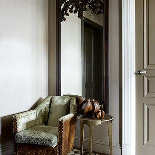 На фото: прихожая в стиле современная классика с серыми стенами и разноцветным полом с