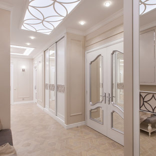 Entryway - large transitional ceramic floor and beige floor entryway idea in Saint Petersburg with beige walls and a white front door