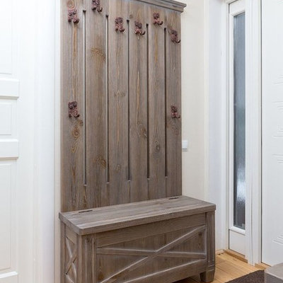 Entryway - mid-sized cottage light wood floor entryway idea in Moscow with beige walls