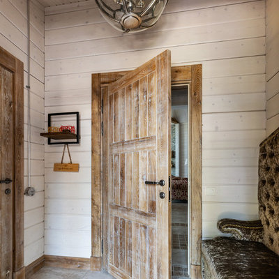 Example of a small farmhouse porcelain tile and beige floor entryway design in Saint Petersburg with beige walls and a medium wood front door
