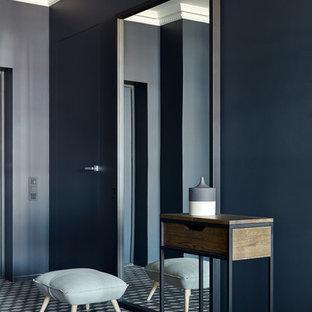 На фото: прихожая в современном стиле с синими стенами, разноцветным полом, одностворчатой входной дверью и синей входной дверью с