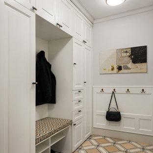 На фото: прихожая в стиле современная классика с белыми стенами и бежевым полом с