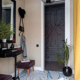 Example of a mid-sized porcelain floor and blue floor entry hall design in Moscow with yellow walls