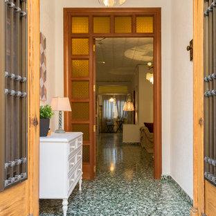 На фото: коридор среднего размера в средиземноморском стиле с полом из терраццо и зеленым полом с