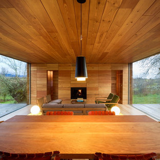 This is an example of a large country open concept family room in Madrid.