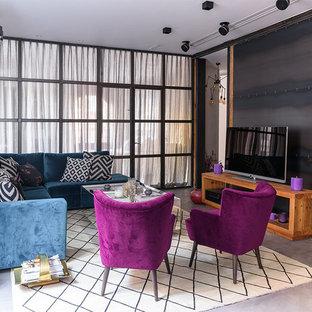 Modelo de sala de estar actual, sin chimenea, con suelo de cemento, televisor independiente y suelo gris