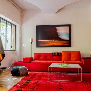Свежая идея для дизайна: изолированная гостиная комната среднего размера в современном стиле с белыми стенами, паркетным полом среднего тона и стандартным камином без ТВ - отличное фото интерьера