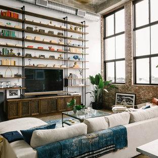 Modelo de sala de estar urbana con paredes blancas, suelo de cemento y televisor colgado en la pared