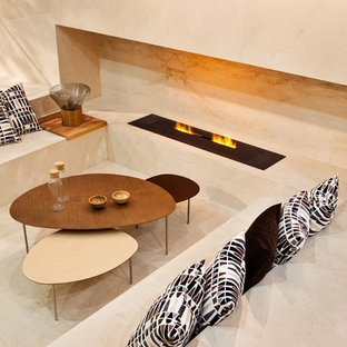 Contemporary games room in Other with marble flooring, a ribbon fireplace and a stone fireplace surround.