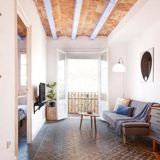 Foto de sala de estar mediterránea, de tamaño medio, con paredes blancas y suelo de baldosas de cerámica