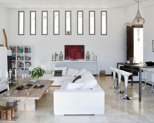 large open concept and formal travertine floor living room idea in madrid with white walls
