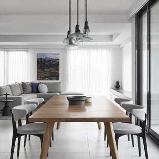 Inspiration for a modern open plan dining in Melbourne with white walls and grey floor.