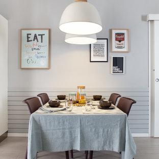 Esempio di una sala da pranzo minimal di medie dimensioni con pareti grigie e pavimento in gres porcellanato